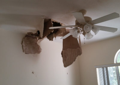10 roof leak causing damage to ceiling