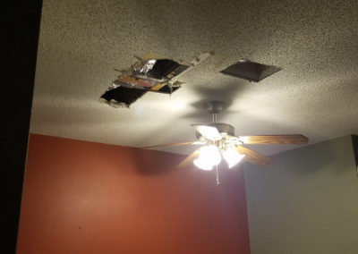 11 Holes cut in ceiling to dry out ceiling