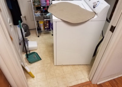 3 Laundry room - checking washer to make sure it is not a washer leak