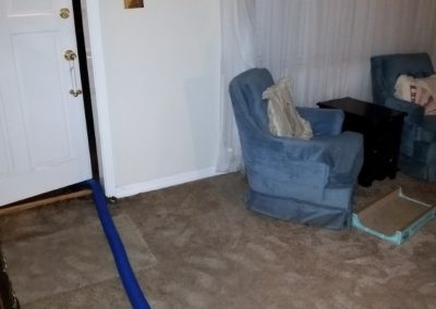 6 wet carpet in front room of house (area is higher than back of home)